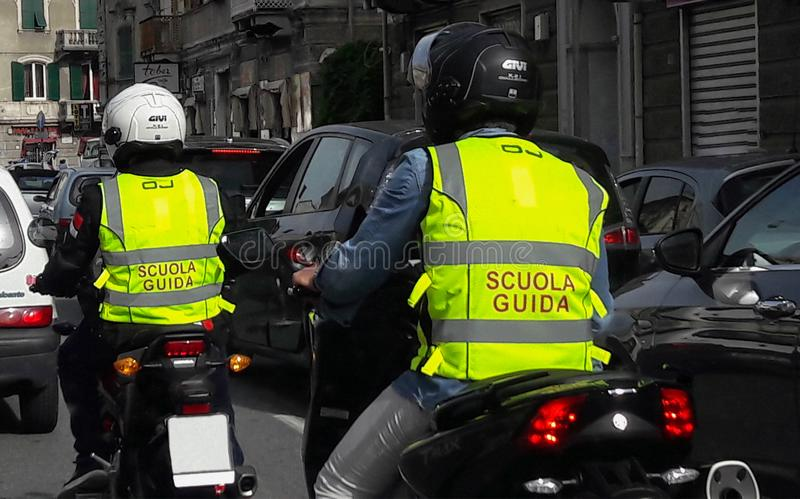 Motorbike school on the busy road in the city of Genoa Genova Italy. Motorbike school on the busy road in the city of Genoa Genova Italy, Europe royalty free stock photography