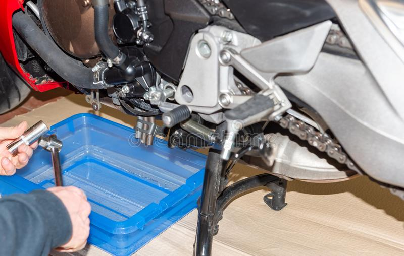 Motorbike in the a service station with oil Change - Serie repair workshop.  stock photography