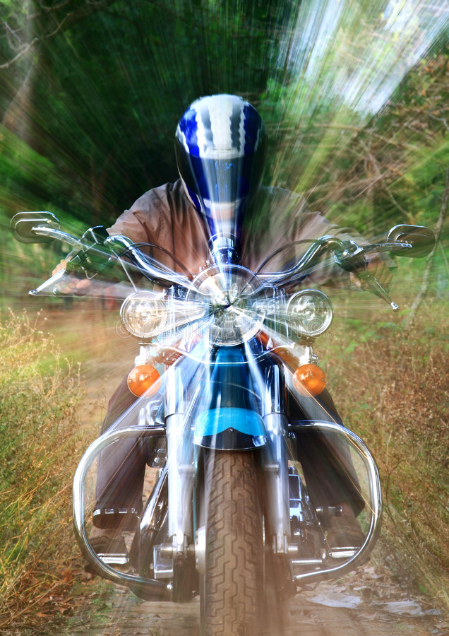 Motorbike speeding in frontal royalty free stock photo