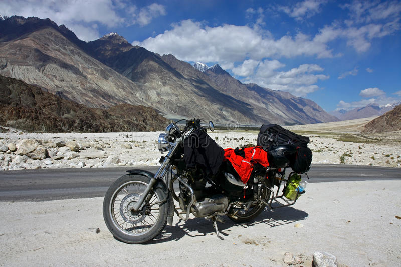 Motorbike stop in mountains. Of himalaya stock photos