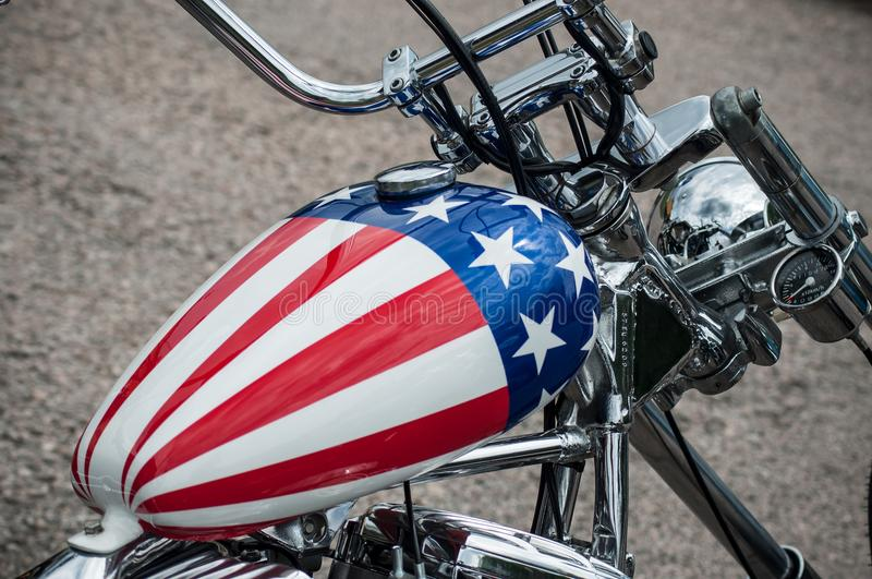 motorbike tank with american flag painting on Harley Davidson motorbike parked in the street stock images
