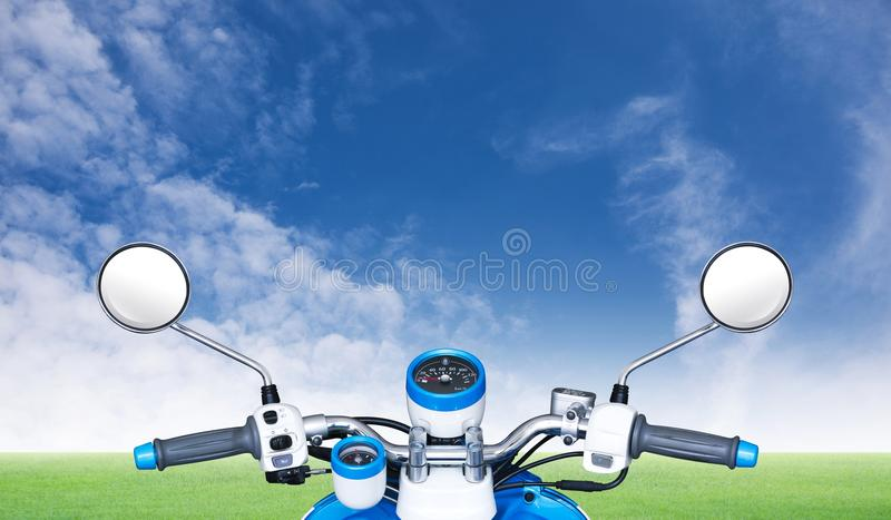 Motorbike on view. Motorbike on grass and sky landscapes view royalty free stock images