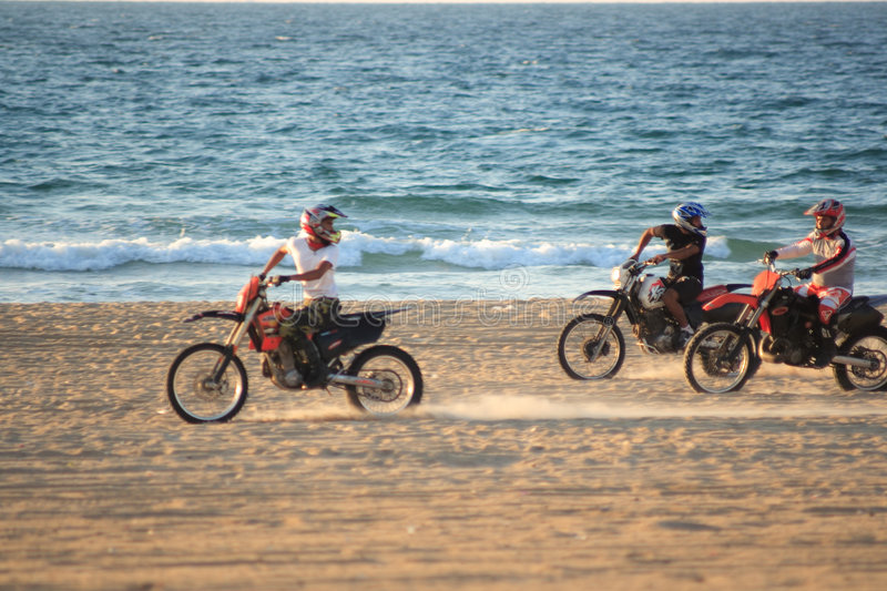 Motorbikes on the beach #4. Motorbikes on the sunset beach royalty free stock images