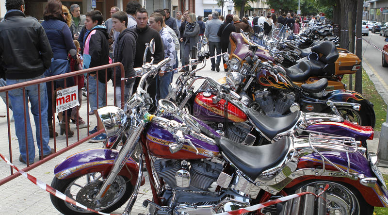 Motorbikes exhibit. Visitors pass next to an exhibit of custom motorbikes in the villageof inca in the Spanish island of Mallorca, during the celebration of a stock image