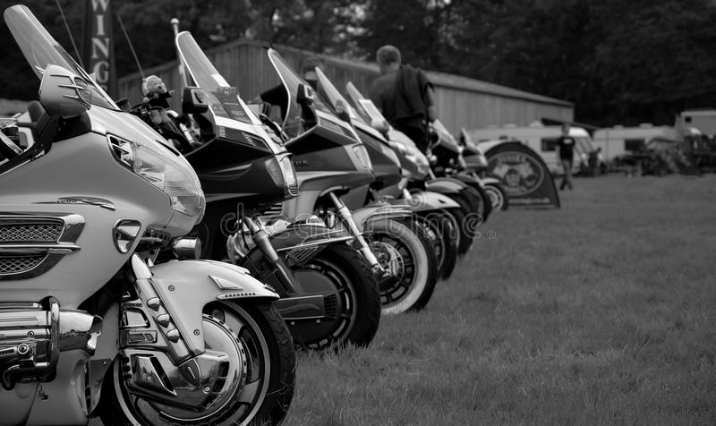 Motorbikes. A line of motorbikes at a local farm exhibition for steam and petrol enthusiasts royalty free stock photo