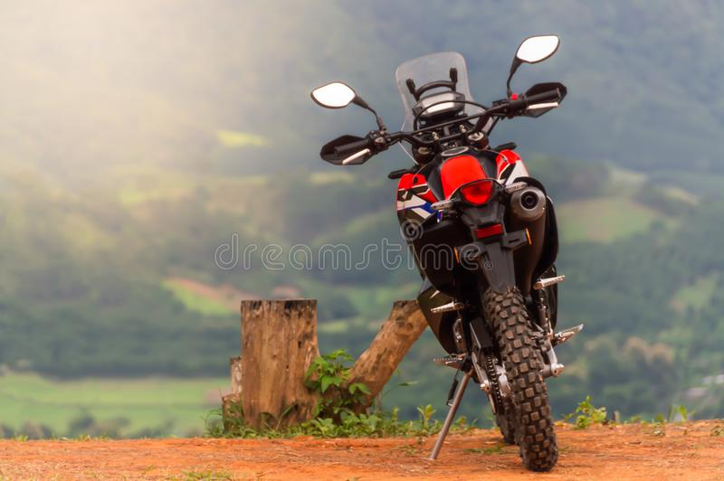 Motorbikes, mobility vehicles parked on the soil ground. It`s a mountain point of travel attraction in Thailand, with blurred soft nature background royalty free stock photo
