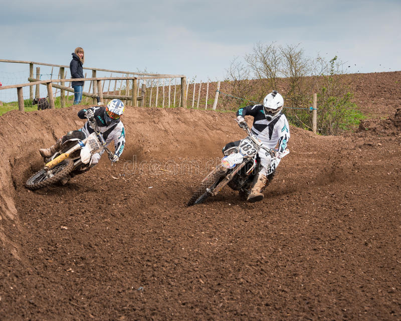Motorbikes Overtaking. Worcester,UK-April 24 2016 :A competitor taking part in a Motocross race.Motocross is an extreme sport with venues in many countries stock photos