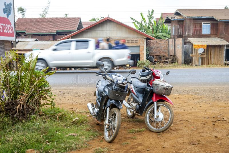 Motorbikes parked next to the road, Laos royalty free stock image