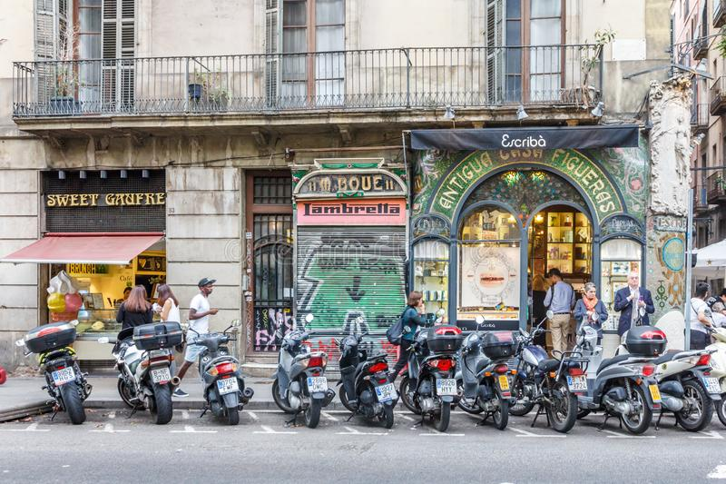 Motorbikes parked outside shops on Las Ramblas. Barcelona, Spain - 4th October 2017: Motorbikes parked outside shops on Las Ramblas. The street is very famous stock images