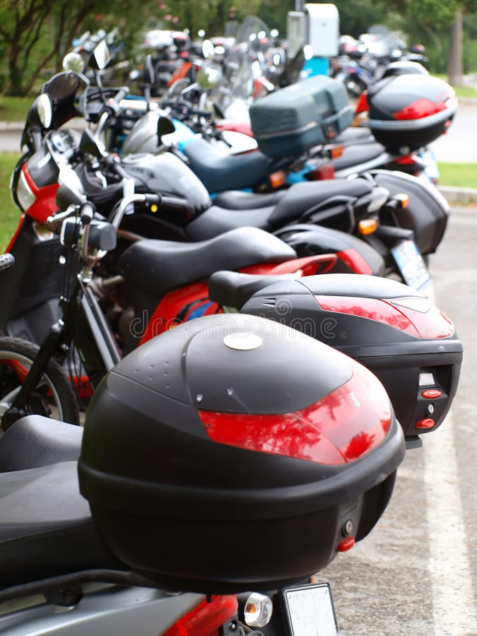 Motorbikes parking. Different motorbikes parking. Perspective view stock photography