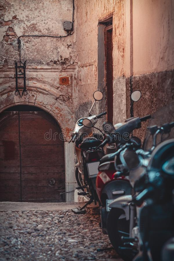 Motorbikes in Rhodes. Parked motorbikes along the walls of Rhodes Fortress, surrounded by old architecture royalty free stock images