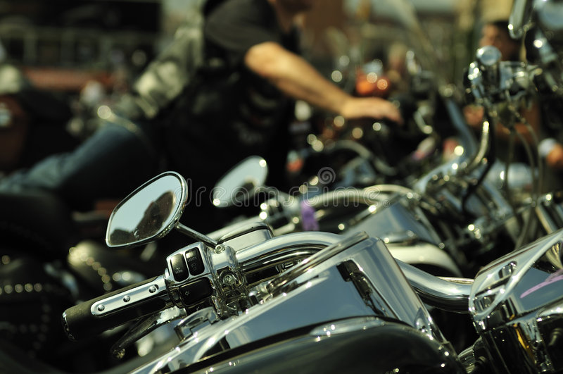 Motorbikes in a row. Plenty motorbikes in a row royalty free stock image