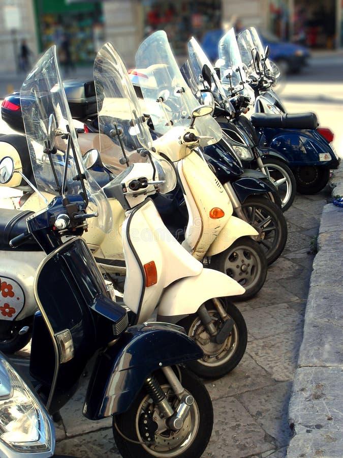 Motorbikes row. Motorbikes arranged in row on the street stock images