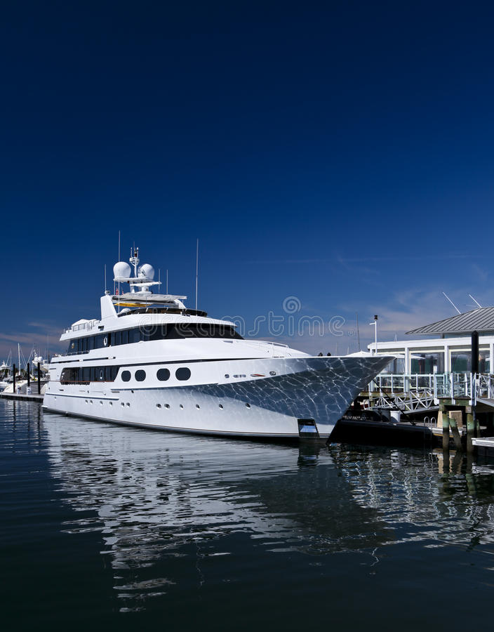 Motorboat. White unmarked luxurious motorboat docked in port royalty free stock image