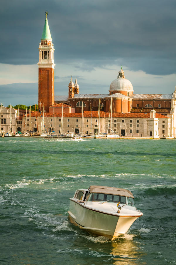 Motorboat and Church of San Giorgio Maggiore in Venice royalty free stock photo