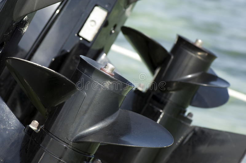 Motorboat engine. Against sea water, closeup royalty free stock photo