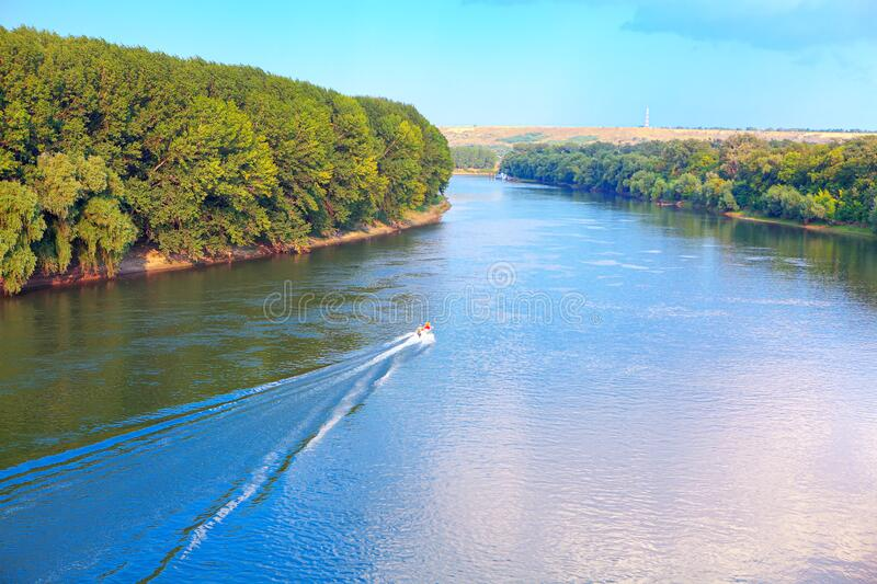 Motorboat on the river. Traveling by motorboat on the river royalty free stock photography