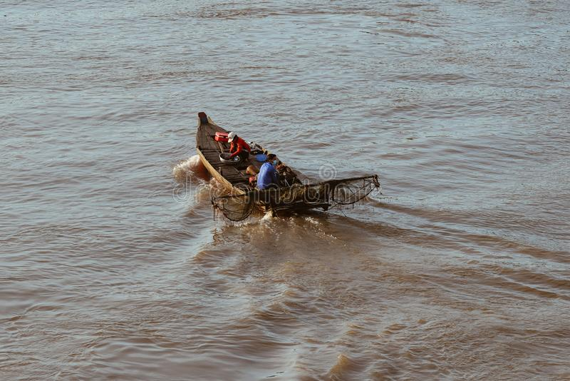 A motorboat running on Mekong River stock photography