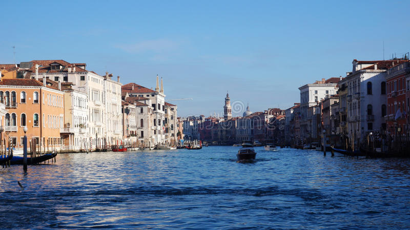 Motorboat is sailing on Grand Canal in Venice, Italy. VENICE, ITALY - JAN 26: Motorboat is sailing on Grand Canal in Venice, Italy on January 26, 2015 royalty free stock photo