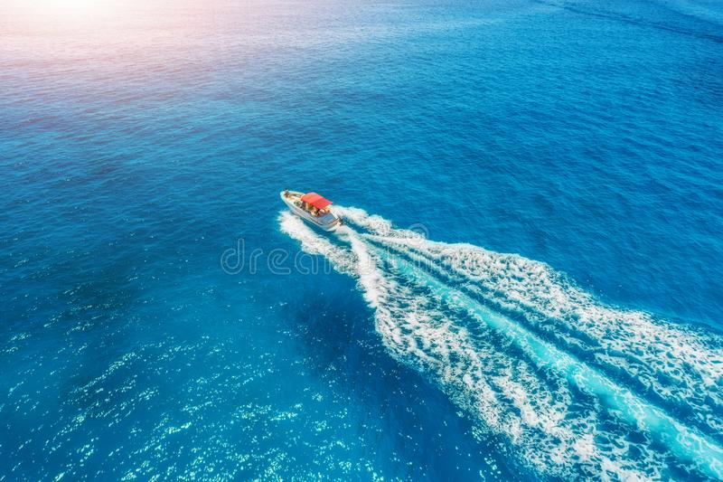 Motorboat at the sea in balearic islands at sunset. Aerial view stock photos