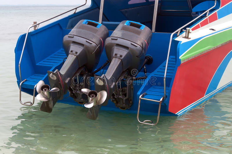 Motorboat. With two motors raised over sea water royalty free stock images
