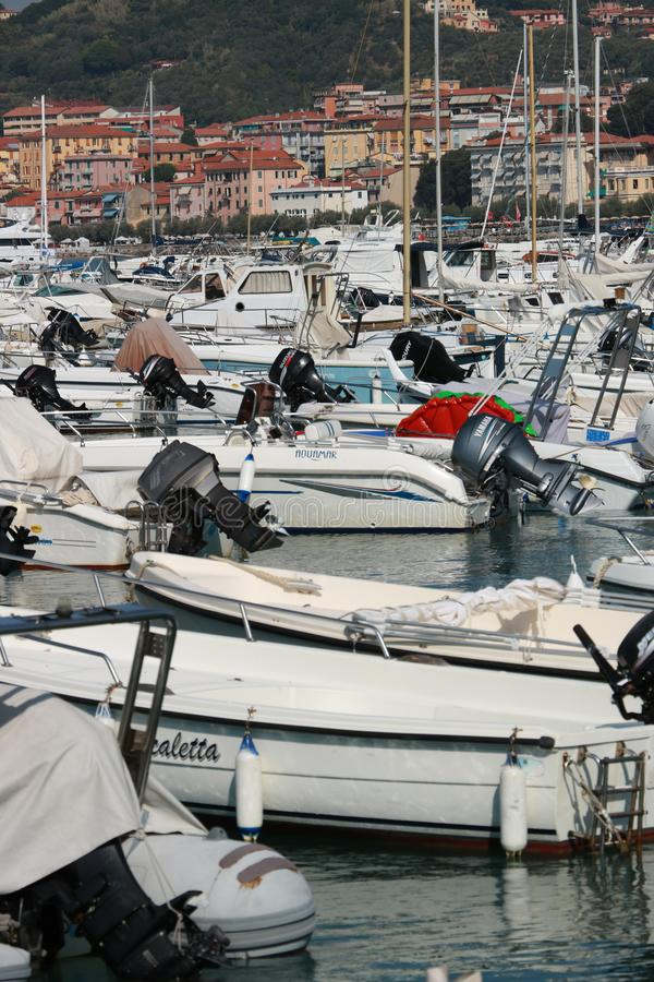 Motorboats anchored in the port of Lerici. In the background the houses of the village stock image