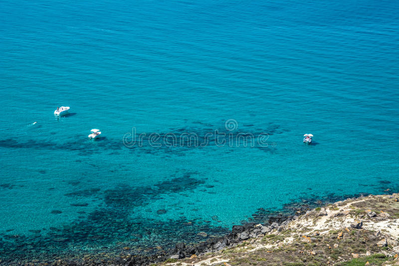 Motorboats in turquoise sea stock photos