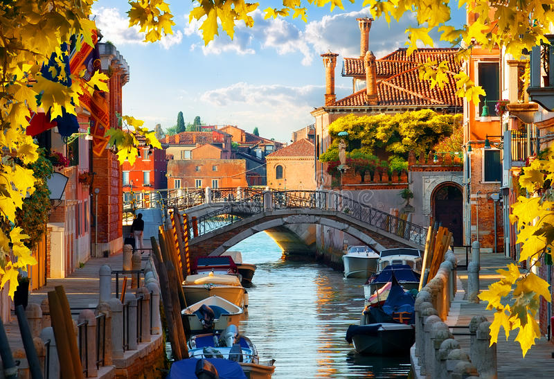 Motorboats in Venice autumn stock images