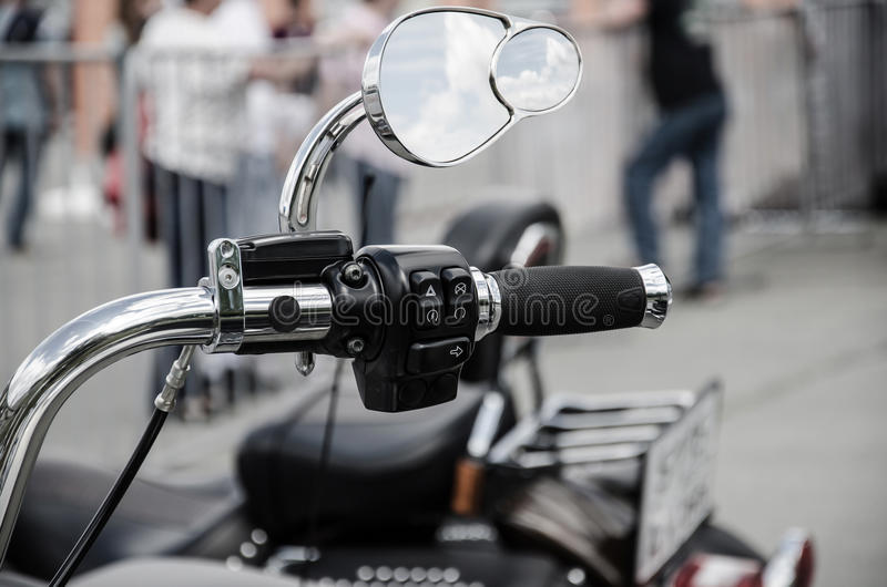 Motorcycle accelerator handle with mirror royalty free stock photo
