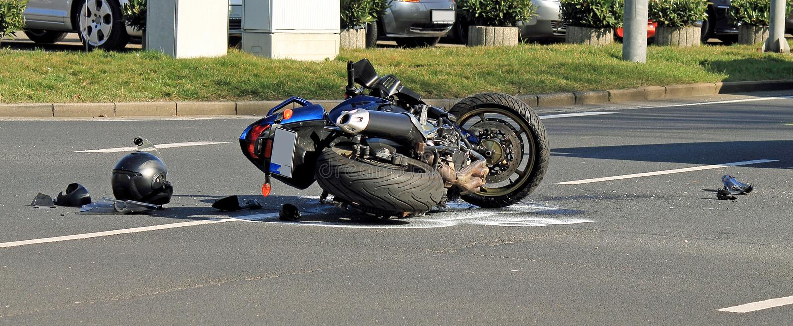 Motorcycle accident on a city road stock photos