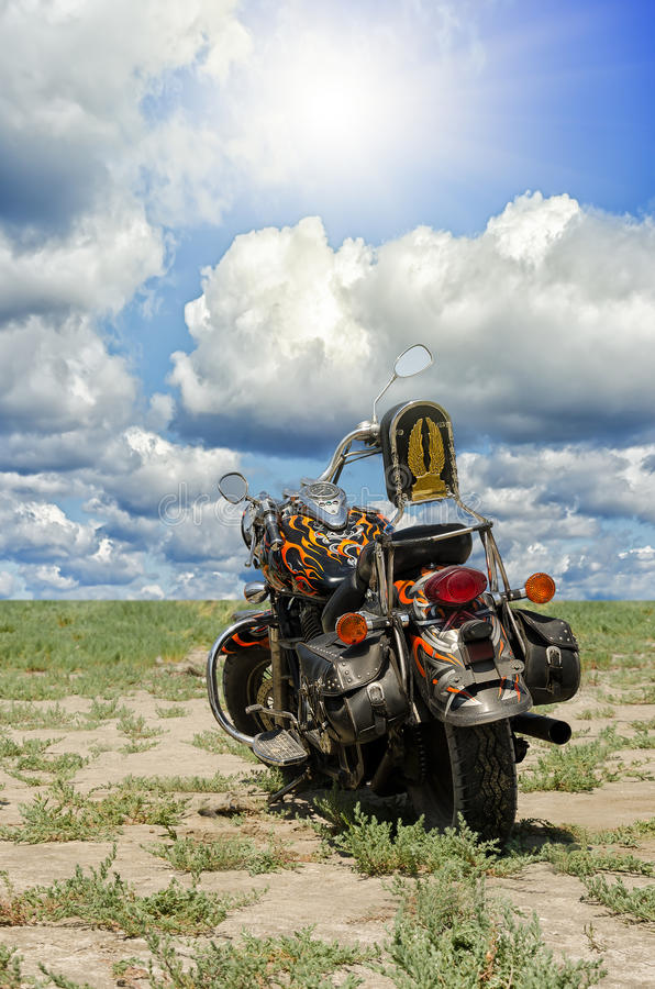 Motorcycle on a background of the cloudy sky stock image