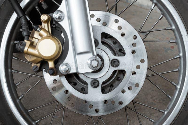 Motorcycle brake disc. Close up of motorcycle brake disc stock photo