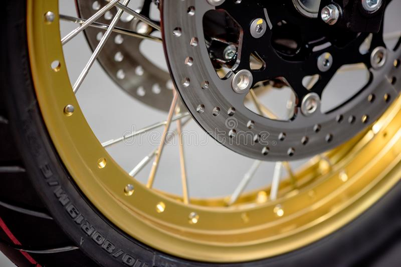 Motorcycle brake disc. Close up of a motorcycle brake disc with golden rim royalty free stock photo