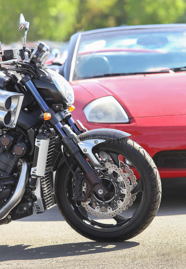 Motorcycle and car on the road stock images
