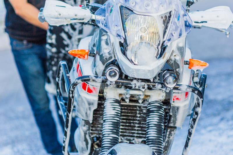Motorcycle Car Wash Motorcycle Big Bike cleaning with foam injection. Make more clean royalty free stock photos