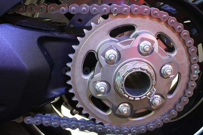 Motorcycle chain. Main article: Motorcycle framenThe frame is typically made from welded aluminium or steel (or alloy) struts, with the rear suspension being an stock images