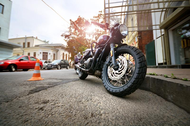Motorcycle in a city. Cool motorbike parked on a street parking lot. In downtown royalty free stock image