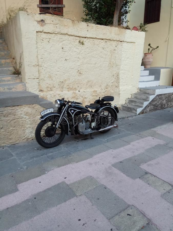 Motorcycle, classic, oldtimer, BMW, Caferacer. The oldtimer motorcycle parked in front of the entrance in the old town stock photo
