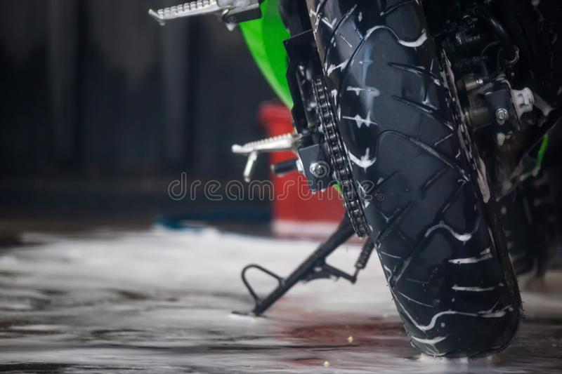 Motorcycle clean service. Employees are washing motorbikes. Motorcycle clean service. Employees are washing motorbikes stock photos