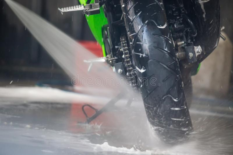 Motorcycle clean service. Employees are washing motorbikes. Motorcycle clean service. Employees are washing motorbikes royalty free stock photos