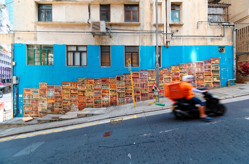 A motorcycle courier passing by the famous Graham Street Wall Mural stock photography