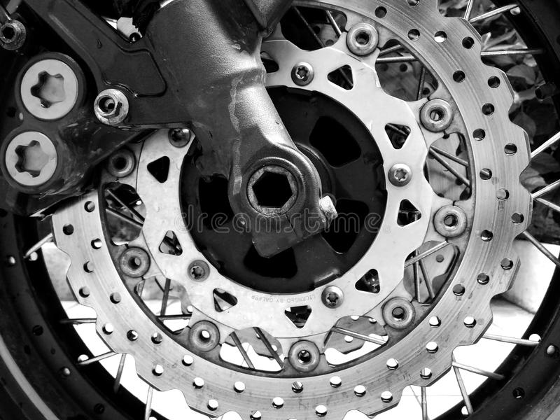 Motorcycle disc brake. Beautiful composition of the disc brake of a motorcycle. It is made of steel and looks like an abstract artwork. This image can be stock photography