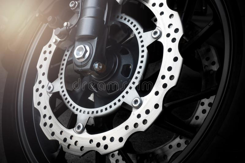 Motorcycle disk brake with ABS system stock image