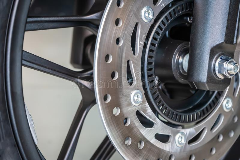 Motorcycle disk brake with ABS system . front wheel Motorcycle b royalty free stock image
