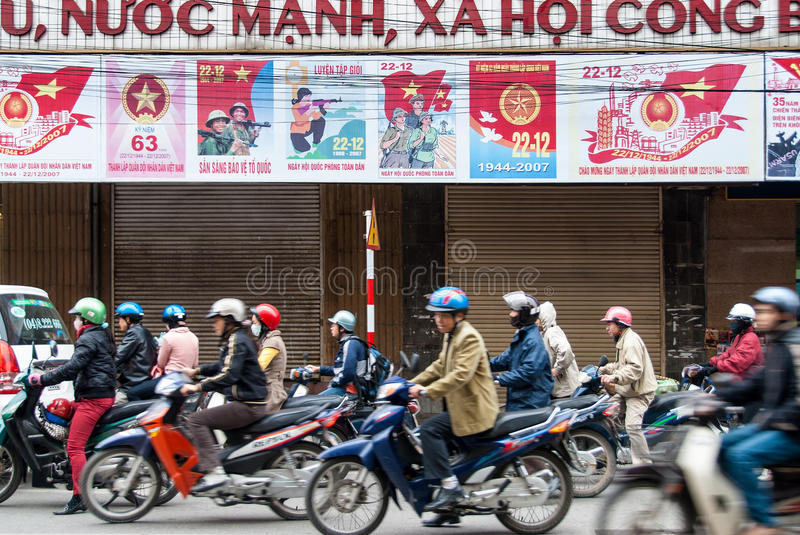 Motorcycle drivers in Hanoi, Vietnam royalty free stock image