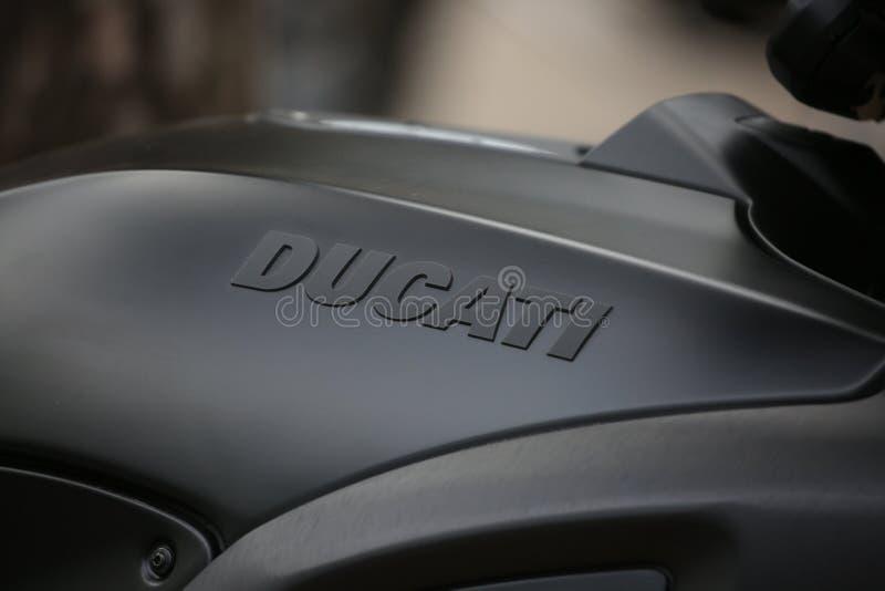 Motorcycle Ducati Diavel matt black. Brand name on petrol tank close-up. Time of opening of motoseason 2018. Komarovo. Resort area of the Saint-Petersburg stock photography