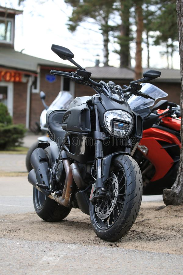Motorcycle Ducati Diavel matt black. Front view on cloudy day. Time of opening of motoseason 2018. Komarovo. Resort area of the Saint-Petersburg, Russia royalty free stock photography