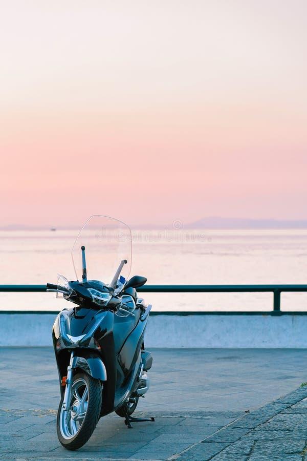 Motorcycle on embankment of Sorrento stock photo