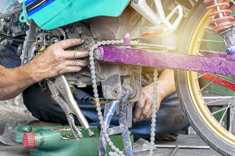 Motorcycle engine repair workers are working hard. stock photography