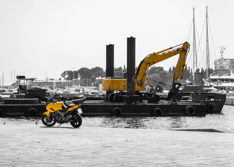Motorcycle with an excavator in black and yellow royalty free stock image